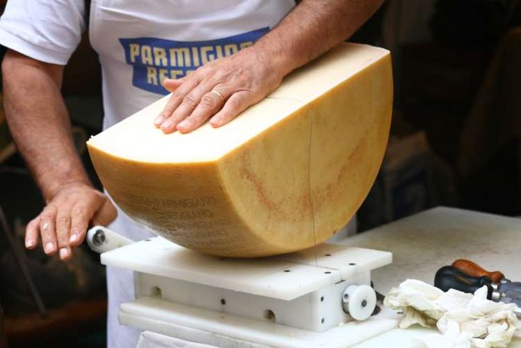 A half-wheel of parmigiano, best handled by the professionals. Image by andrea castelli / CC BY 2.0