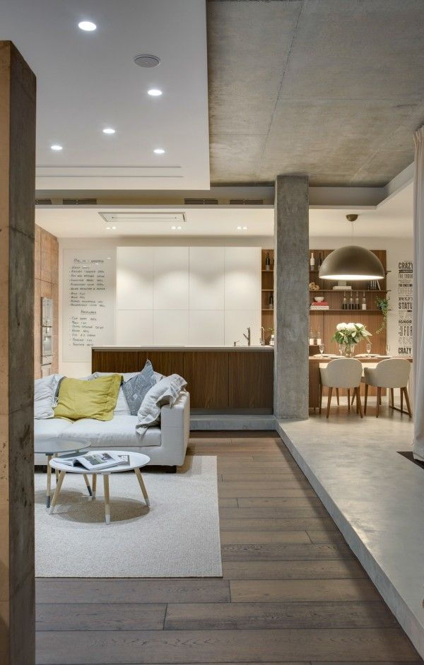 With a mixture of concrete and wood, the design certainly takes a turn towards warm industrial, though the designers didn't set out to make a modern loft.