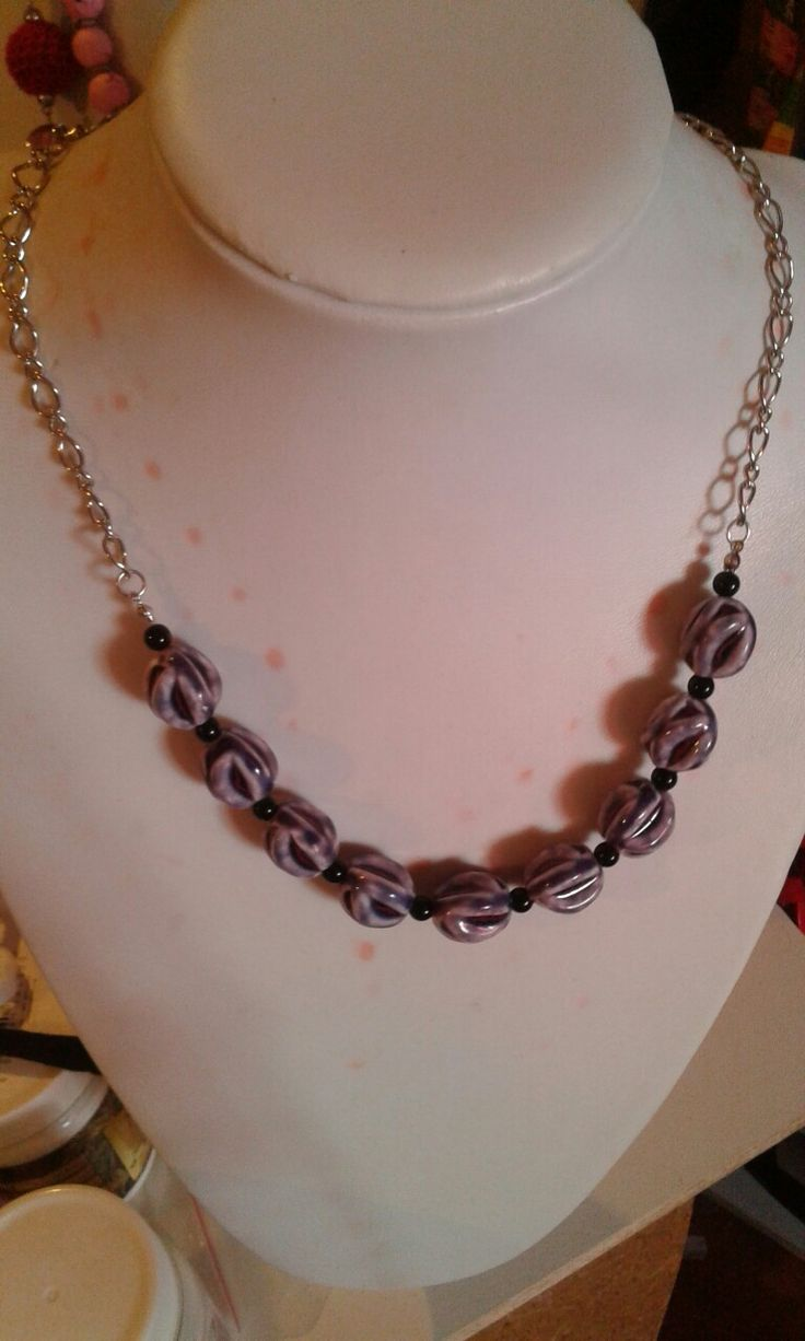 purple and black necklace with chain