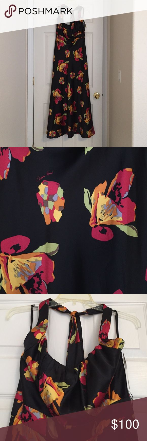 Black floral dress. Brand New! Still with tags! Never been worn. Black dress with multi color flowers. Comes with a stretchable belt. The dress has a halter neck that you tie in the back. Donna Ricco Dresses