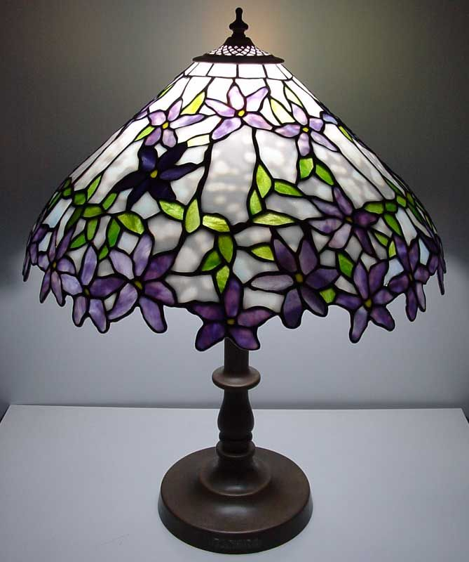 Incredible work may not be tiffany but is · stained glass lamp