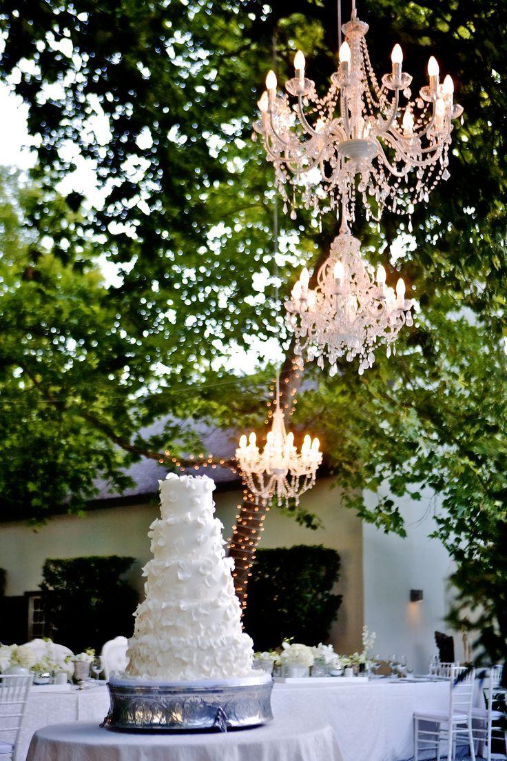 A wedding under the stars, with elegant stylised crystal chandeliers at Gabi & Dougies wedding