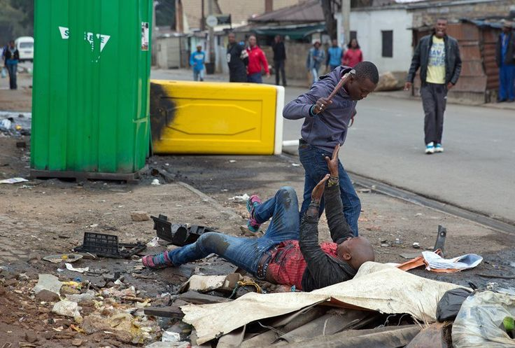 Brutal death of Emmanuel SIthole. In his pockets, R285 and 10c in change and a cellphone. His phone would ensure he did not die nameless.  xeno murder 1.JPG