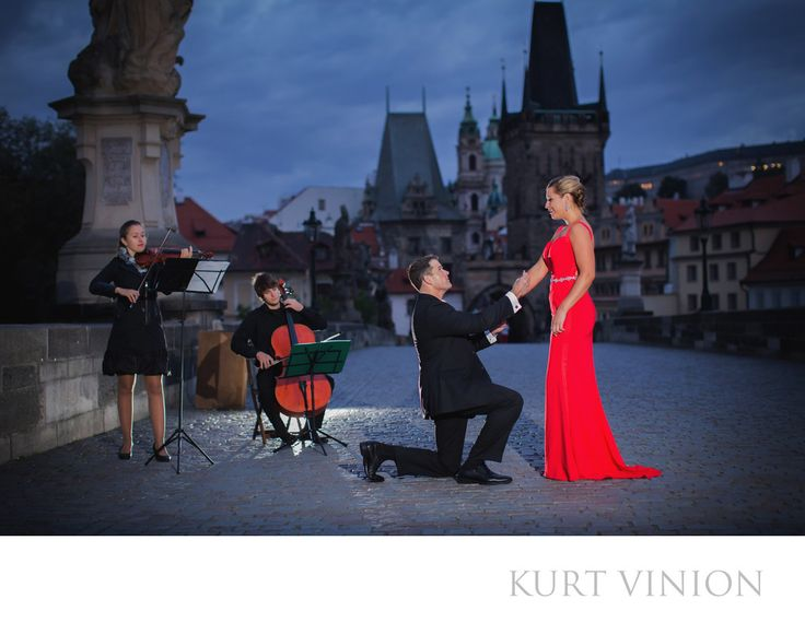 London wedding & Prague pre wedding photographer - A romantic wedding proposal on the Charles Bridge: L&G romantic engagement portrait session atop the Charles Bridge in Prague. Keywords: Prague Engagement Photography (24).