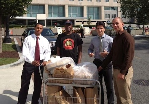 Community Service  Georgetown Bagelry donated 50 dozen bagels for families, officials and support staff waiting to receive Stevens' body at Andrews Air Force Base. Badara Njai and Lucien Beall Koefoed delivering. Fredde Lieberman photographer...
