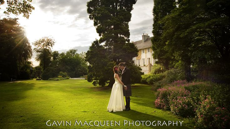 The Happy Couple on the lawn in the fairytale setting of House for an Art Lover.