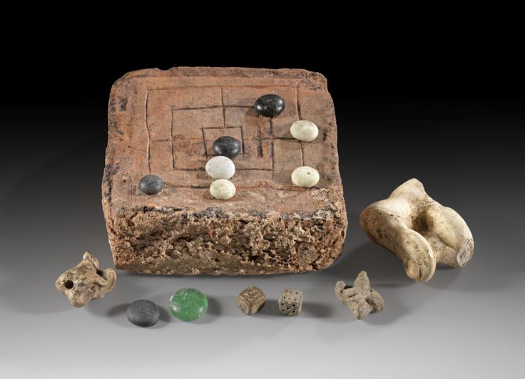 Roman game, set of Roman play equipment, 1st-3rd century A.D. Terracotta tile with post hoc engraved mill game, nine tokens made of greenish glass, dark and white stone, two dies made of dark stone, two astragaloi from animals and one made of lead for the game knucklebones, terracotta tile 13 x 12 cm. Private collection