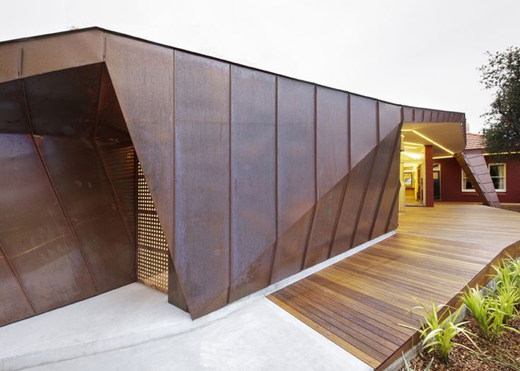 The faceted copper envelope of this house extension near Sydney was designed by architects Innovarchi to resemble a roof.