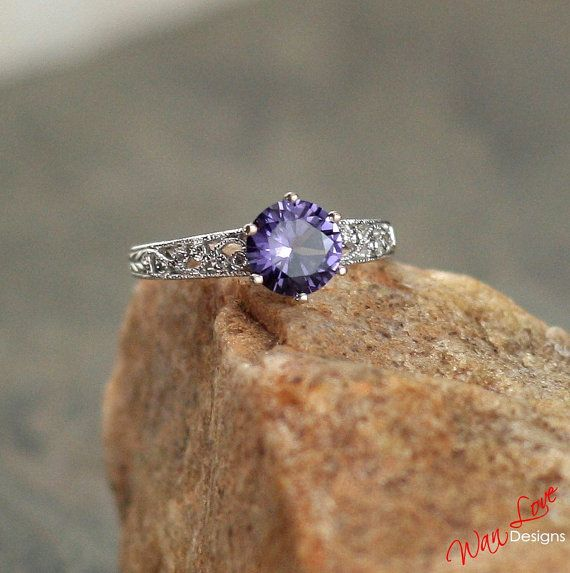 Alexandrite Color Change Sapphire Diamond Filigree Milgrain Solitaire -- This still has the filigree, but is a bit narrower in comparison to the stone, which I like.