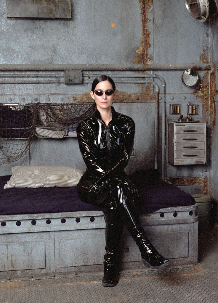 ill-mannered: Carrie-Anne Moss on the set of The Matrix directed by Andy and Lana Wachowski, 1999