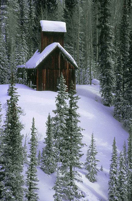 Winter photograph of an old mine on Red Mountain Pass near Silverton, Colorado, USA
