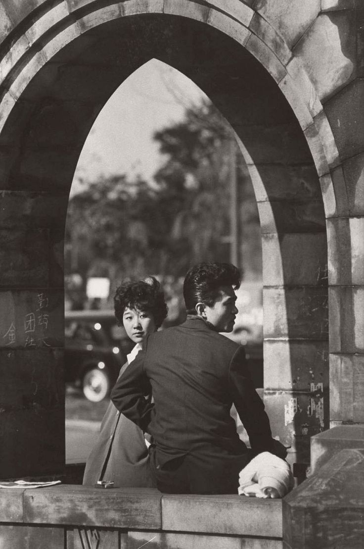 Young couple visiting a bridge near the Imperial Palace. 1959