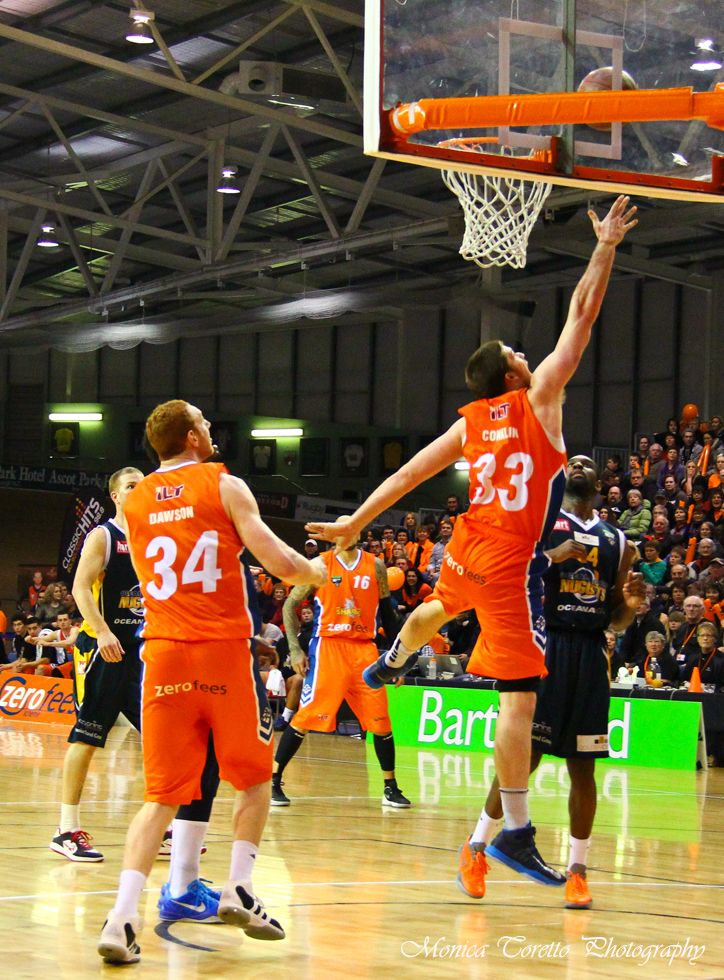 Southland Sharks' Brian Conklin has it all under control as team mate Gareth Dawson watches closely. Stadium Southland, June 21, 2013. Southland Sharks v Otago Nuggets. Southland Sharks 115 - 67 Otago Nuggets.