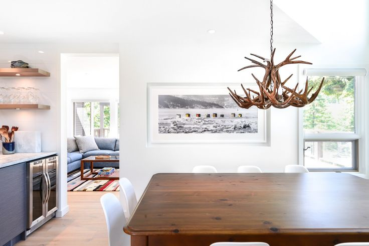 Falken Reynolds - Glacier Drive Dining Room - www.falkenreynolds.com   #antler #chandelier #wood #whistler #white #dining #contemporary #clean #nature