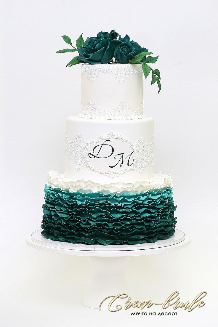A wedding cake. With roses. A cake with flowers. Cake with waves and petals.Green cake.Weeding in green