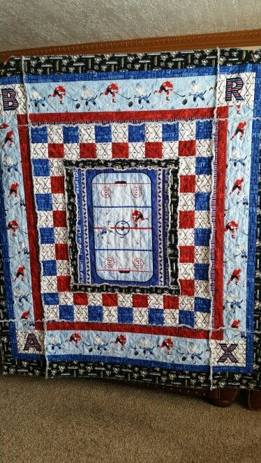 This is the Slap Shot Hockey quilt I made for my grandson Brax.