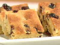 Ingredients: 125gr Butter 1tbsp Golden Syrup 1 cup Coconut 3/4 cup Caster Sugar 1 cup Self-Raising Flour 1 Cup Sultanas 1 Beaten Egg Method: 1) Preheat over to 180C. Gently heat the butter with th…