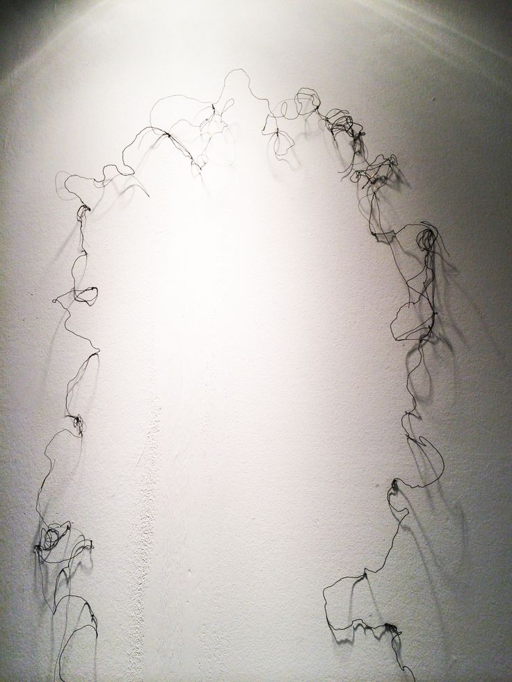 Ciara Blath Stapleton, Silversmithing and Jewellery, Glasgow School of Art - fragile, abstract jewellery which creates sketchy shadows on the wall