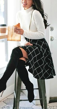 Love this feminine fall look: grid print skirt, solid color turtle neck sweater and over-the-knee boots.