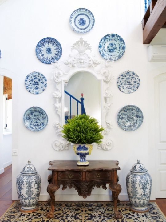 Alberto Pinto. These blue and white plates against the white looks fantastic! And very breakable...