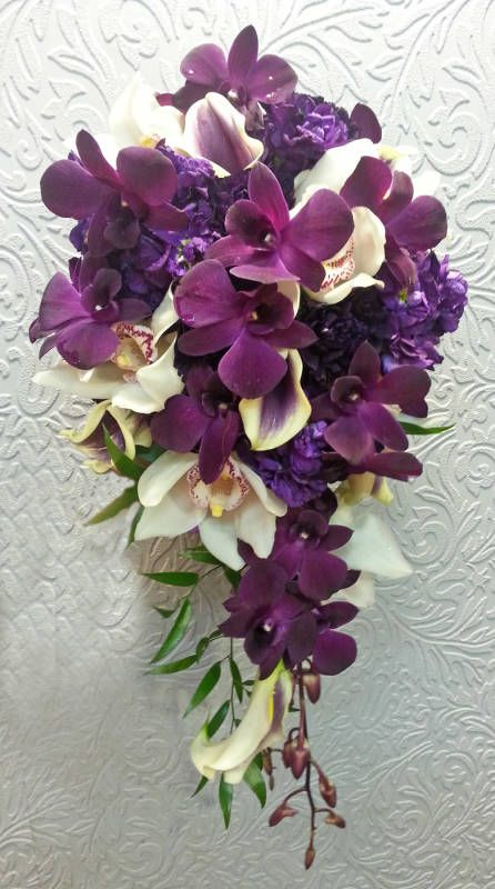 wedding bouquets cascade style | 17. A full lush cascade style wedding bouquet full of dark purple ...