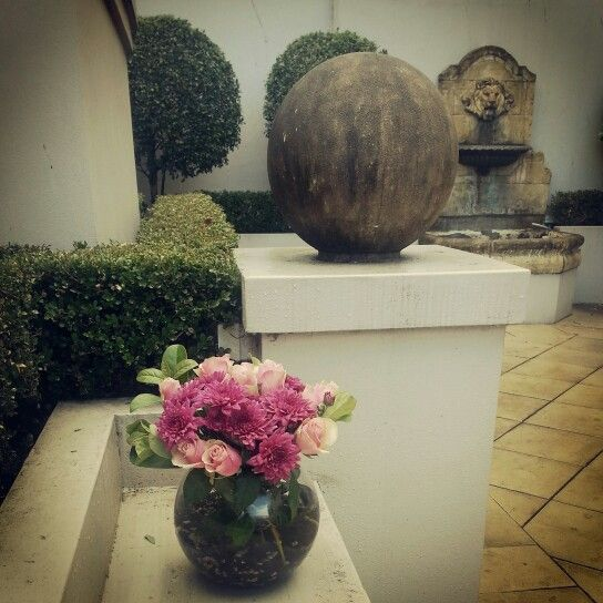 Sandstone boulder,  lion fountain and posy