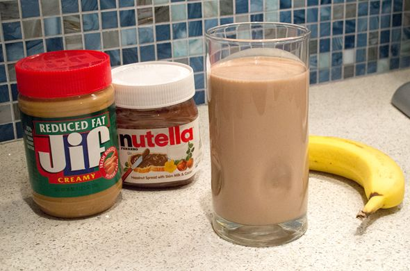 Peanut Butter Nutella Smoothie  ¾ cup vanilla Greek yogurt 1 small-medium banana, sliced ¼ cup reduced fat peanut butter 2 tbs nutella ¼ cup milk (if needed)