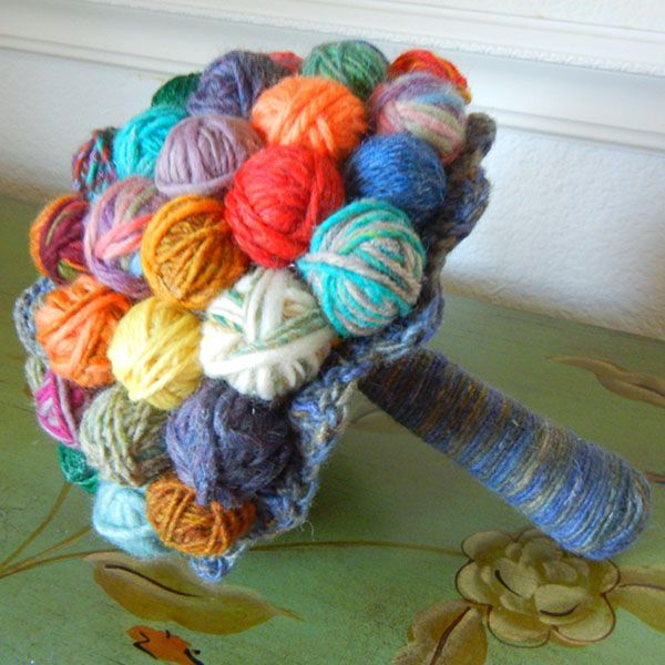 Charm your guests with this adorable yarn ball bouquet from Sew Many Petals.