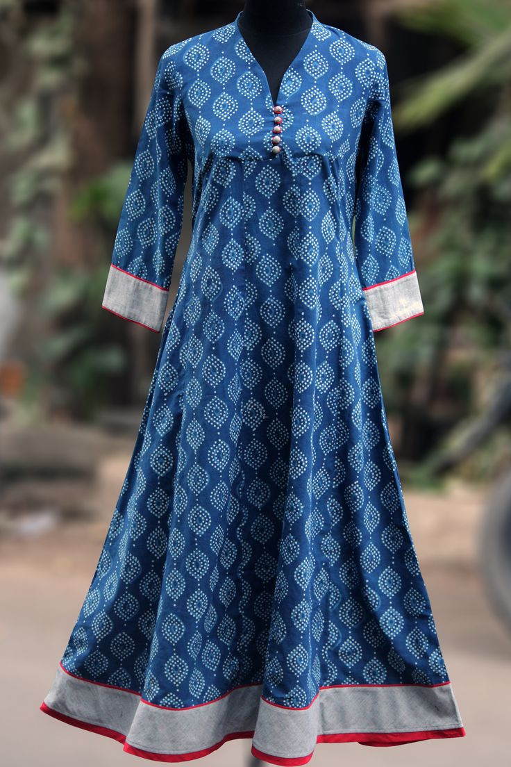 a perfect maxi anarkali with indigo print in flowy style! this anarkali has mangalgiri fabric used in sleeves & border with fabric potli buttons in the fr