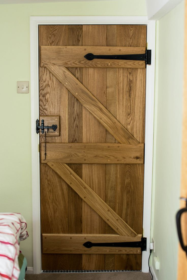Oak Ledged & Braced doors made by Waterhall Joinery Ltd. Each door made of 5 individual Oak panels to give rustic style, complimented with black furniture.