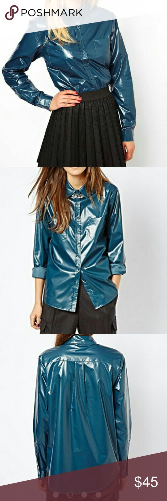 ASOS Blue Wet Look Button Down Shirt Wet Look Shirt Wrinkles can be taken out with light steam  Purchase at listed price to receive a FREE gift! 15% off bundle of 3+ items Any questions? Feel free to ask. Happy Poshing! ASOS Tops Button Down Shirts