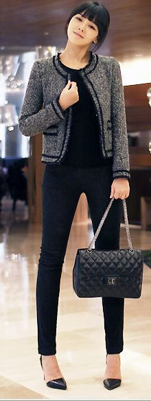 tweed jacket with black clothing and accents