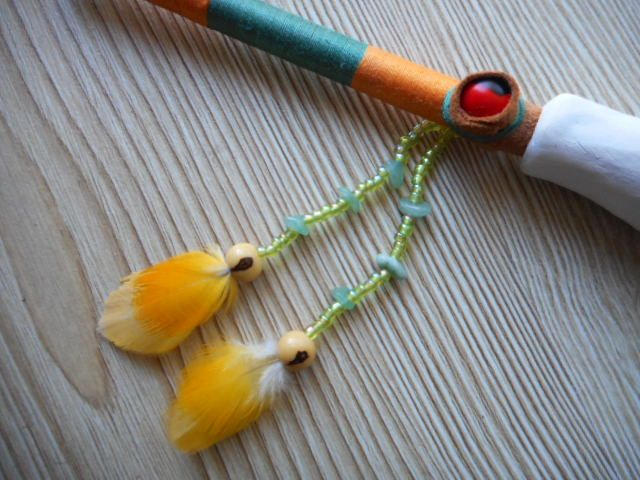 Pipe with white clay stove and bamboo mouthpiece that is decorated with cotton thread, glass beads, green agate, guairuro seed and parrot feathers. Particular of the decoration. www.facebook.com/MotherofWater