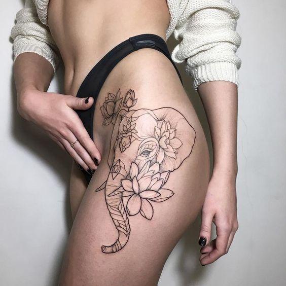 Linework and dotwork elephant and Lotus blackwork flower tattoo