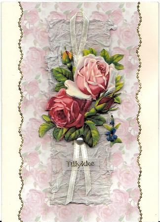 "vintage roses for you on Craftsuprint designed by Angela Wake - made by Bodil Lundahl - On a cream coloured cardstock I glued a wavery cut transparent print of ""Beautiful pink roses background"" (cup42627-376). On top of that a smaller piece of crumbled white silkpaper. Then a cream coloured ribbon with the finished 3D rose on top and a plastic pearl in the bottom of the bouquet. The text on the transparent sign says ""Tillykke"", which means Congratulations in Danish. I finished the card with…"