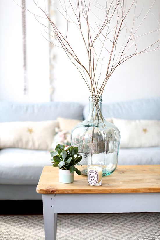 Don't be afraid of large items like a vase on the coffee table. Makes a dramatic effect.