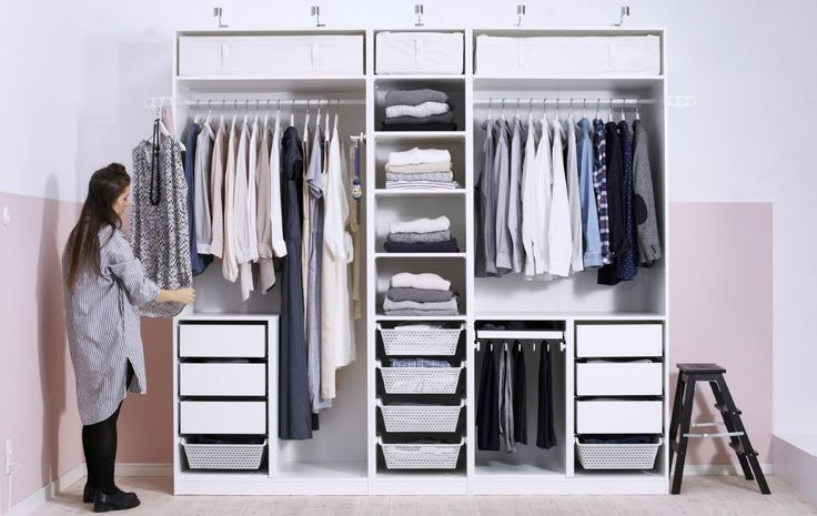 An open, organized wardrobe for a couple