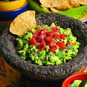 Chunky Guacamole with a Twist courtesy of Boudros's. I leave out the Serrano pepper.