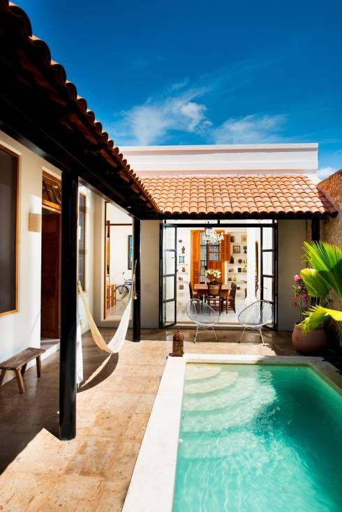 Casa GC55: Albercas de estilo ecléctico por Taller Estilo Arquitectura