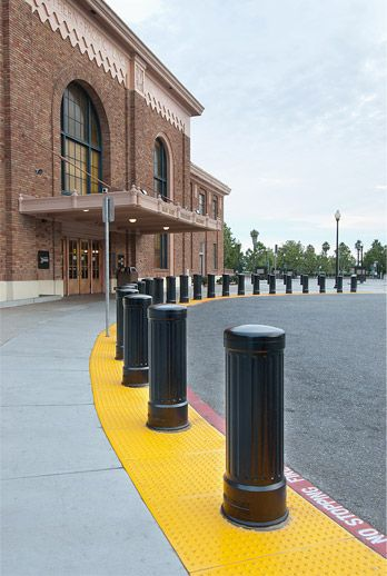 Fluted Iron Bollards: Machine-finished accents add refined sense of style to metal bollards.