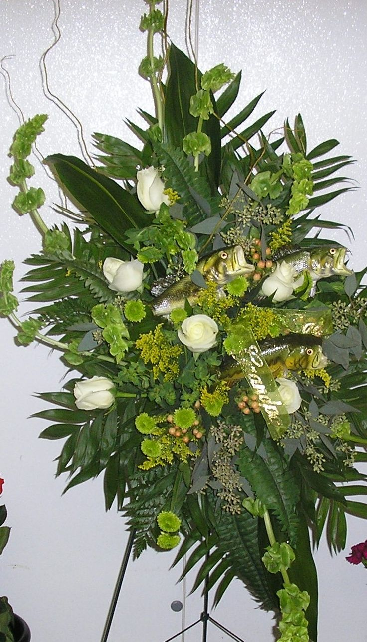 Masculine standing spray for a fisherman funeral