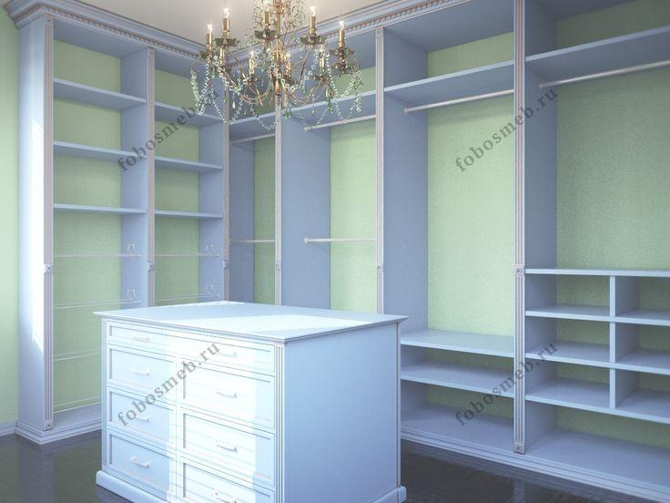 На фото: Белая угловая гардеробная комната с островом