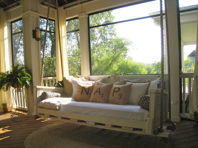 Very cool!! This swing is made from an old door and a twin-size mattress -- and Love the Scrabble pillows!!