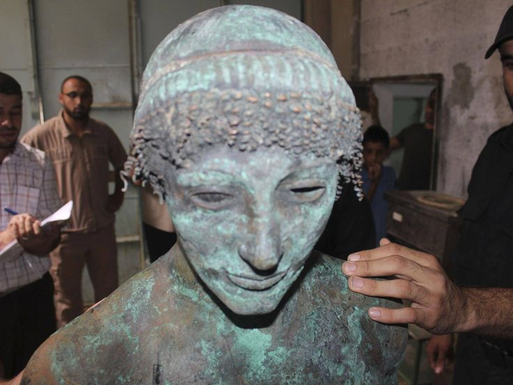 Lost for centuries, a rare bronze statue of the Greek god Apollo has mysteriously appeared in the Gaza Strip, only to be seized by police and vanish almost immediately from view.