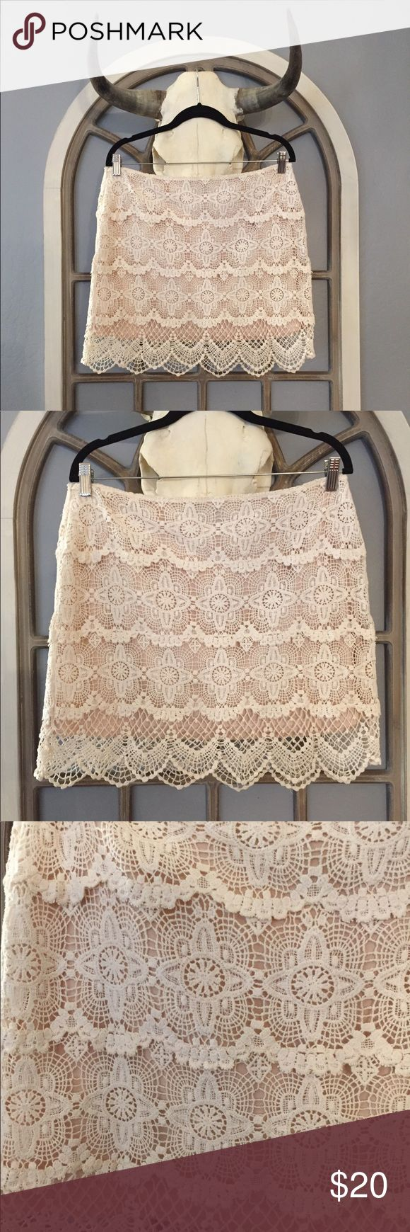 Cream Lace Skirt Beautiful lace skirt. Features a side zipper and is a size large. Laying flat it measures approximately 17 inches at the waist and 18 inches from top to bottom of lace. Jennifer Lopez Skirts
