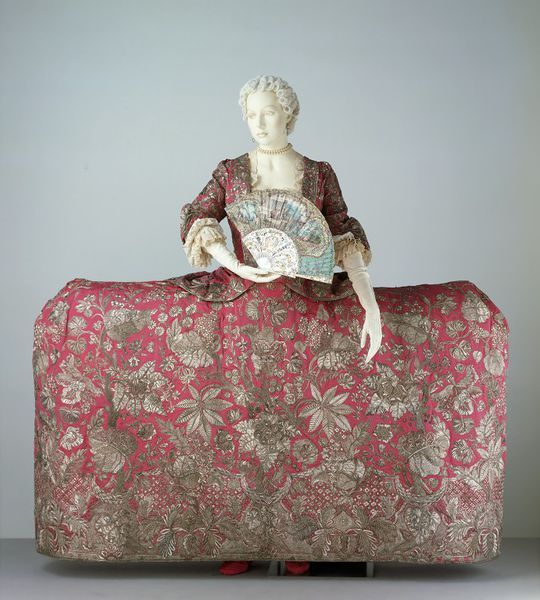 "Mantua  Place of origin: England, Great Britain (made)  Date: 1740-1745 (made)  1920s (altered)  Artist/Maker: Leconte (decorator)  Giles, Magdalene (possibly, maker)  Materials and Techniques: Ribbed silk with silver thread embroidery, couched and worked in satin stitch  Museum number: T.227AB-1970  ""The train is signed 'Rec'd of Mdme Leconte by me Magd. Giles'. The name Leconte has been associated with Huguenot embroideresses working in London between 1710 and 1746."""
