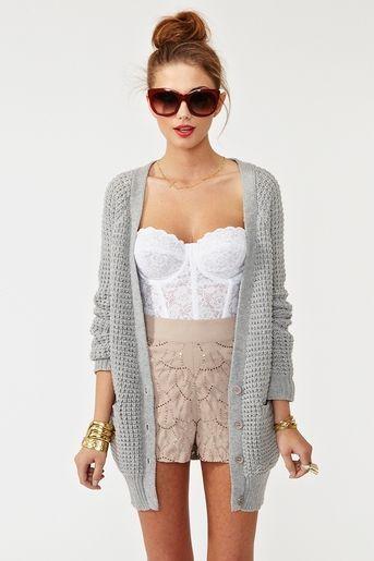 Shop this look on Lookastic:  http://lookastic.com/women/looks/sunglasses-cropped-top-cardigan-shorts-bracelet/7715  — Burgundy Sunglasses  — White Lace Cropped Top  — Grey Knit Cardigan  — Beige Lace Shorts  — Gold Bracelet