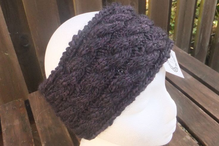 I've knitted this style of ear warmer in this yarn a few times and I only have enough of this yarn to do one more. The random pattern yarn, in shades of purples and black is an alpaca, wool and acrylic mix. This can be machine washed at a 30 degree delicate cycle. £12 + £3 P&P