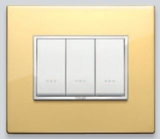 light switch with metal finishing EIKON EVO: ESCLUSIVI GOLD VIMAR
