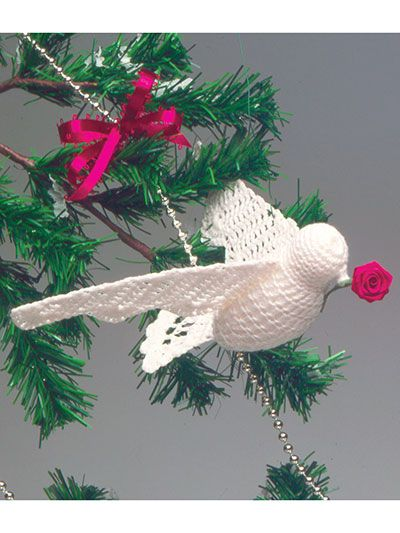 """This delicate dove is made using size 10 crochet cotton. It creates a unique and beautiful Christmas ornament for your tree. Finished size: 4 1/2"""" x 1 1/2"""" with 6 1/2"""" wingspan."""